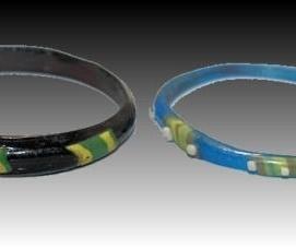 Two Ancient Roman Glass Bracelets. Three polychrome Mosaic glass bracelets. Circa 4th century AD. Size: 2 5/8 inches.