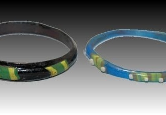 Two Ancient Roman Glass Bracelets. Three polychrome Mosaic glass bracelets. Circa 4th century AD. Size: 2 5/8 inches.